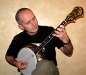 photo of paul conlon playing a Epiphone B tenor banjo